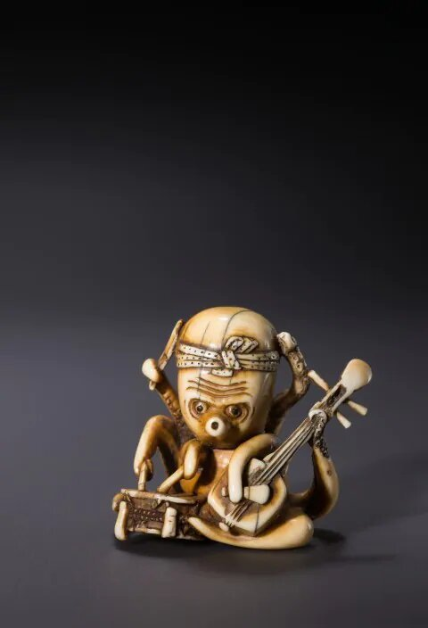 The World's First One-man Band with Eight Arms, artist unknown. Katabori netsuke,