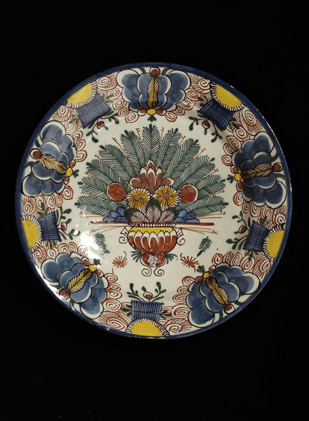 Artist unknown, tin-glazed plate with polychrome decorations, early 18th century,  V&A Museum, London. Delftware