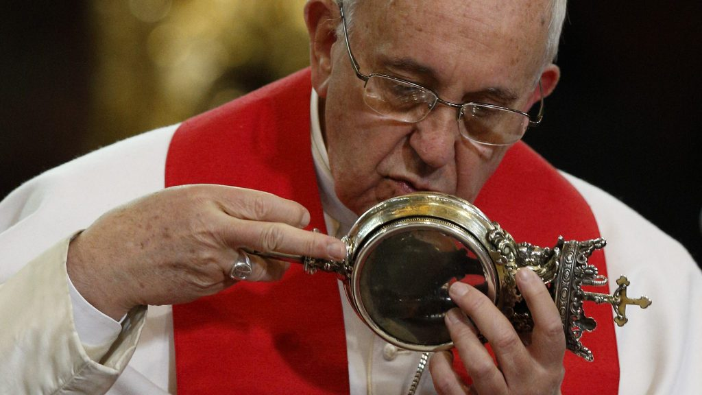 Top 10 Christian Weird Relics: Pope Francis kisses a reliquary containing what is believed to be the blood of St. Januarius during a meeting with religious at the cathedral in Naples, Italy, in 2015
