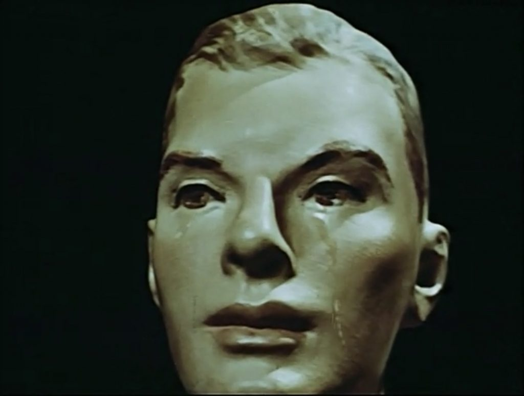 """Male mannequin crying, """"Girl with Prefabricated Heart"""" scene from Dreams that money can buy, 1947."""