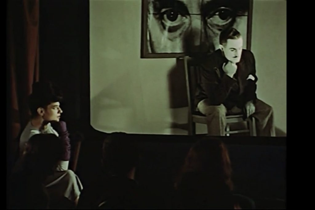 """The Audience repeating various poses and gestures of the man on the screen, """"Ruth, Roses and Revolvers"""" scene from Dreams that money can buy movie, 1947."""