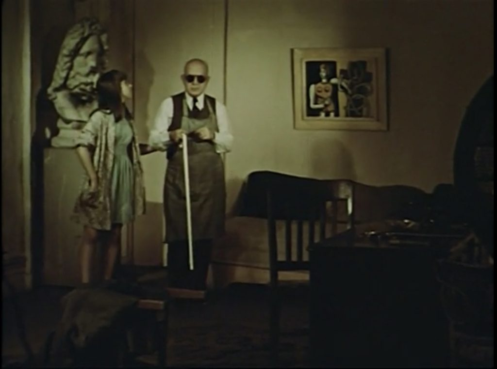 """A blind old man (Alexander Calder) accompanied by a little girl entering Joe's office, """"Ballet"""" and """"Circus"""" scene from Dreams that money can buy, 1947."""