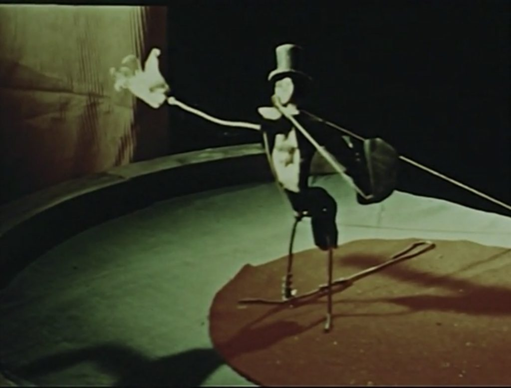 """Alexander Calder's circus figure, """"Circus"""" scene from Dreams that money can buy movie, 1947."""