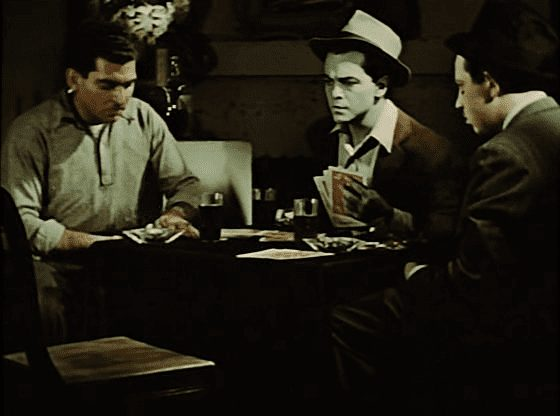 """Joe playing poker with his friends around a table and turning blue, """"Narcissus"""" scene from Dreams that money can buy movie, 1947."""