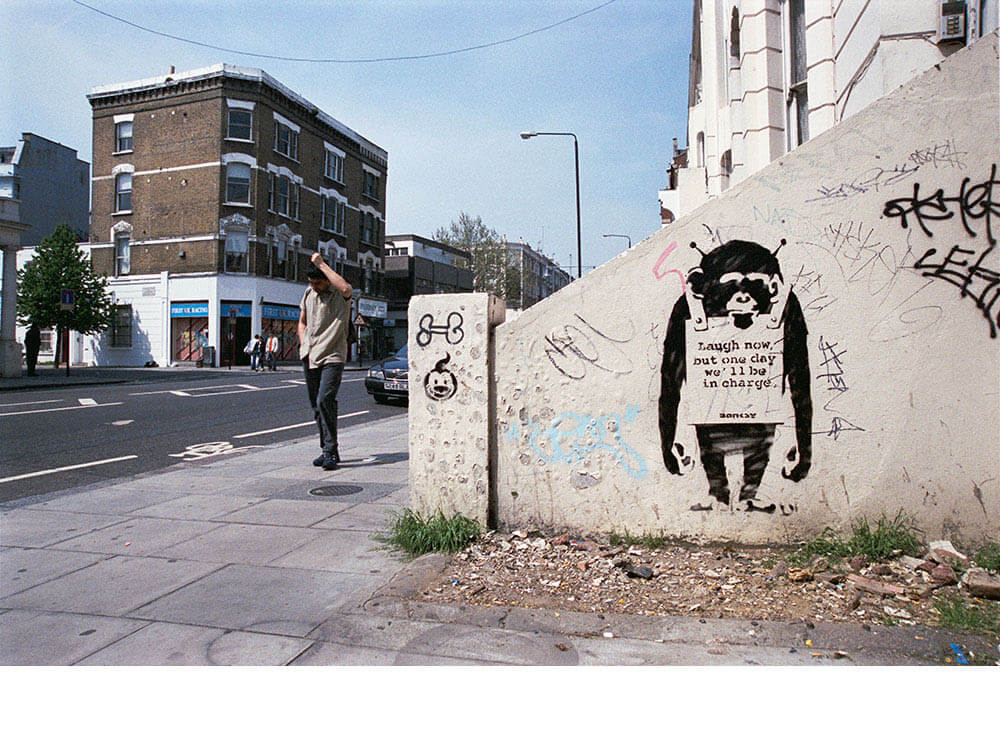 Banksy city guide 2021: Banksy, Laugh now, but one day we'll be in charge, 2002