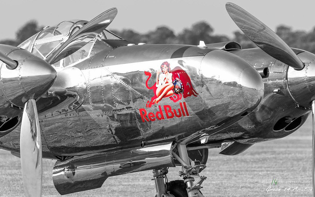 Red Bull Flying Bulls P-38 Lightning airplane with Pinup Nose Art.