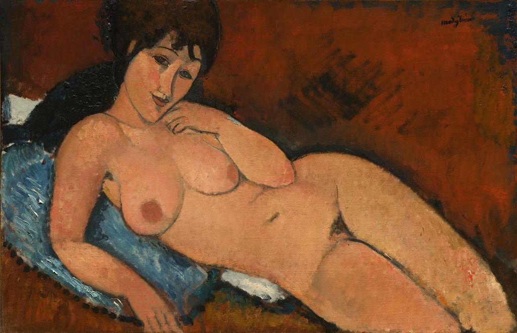 Amedeo Modigliani, Nude on a Blue Cushion, 1917, National Gallery of art, Washington D.C A naked woman is lying on her back, facing the spectator who she is watching. A blue cushion is under the high half of her body.