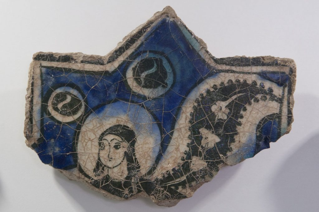 Ceramic tile fragment of mythical creature.
