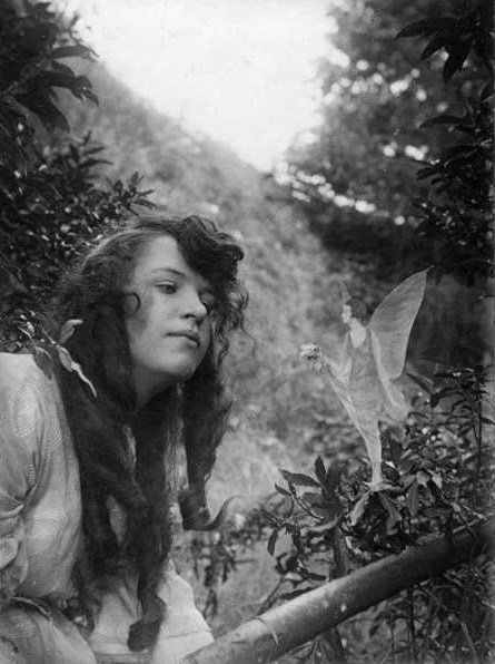 Secrets of ghost photography:  Frances Griffiths, Fairy Offering Posy of Harebells to Elsie, 1917, Cottingley, England, UK.