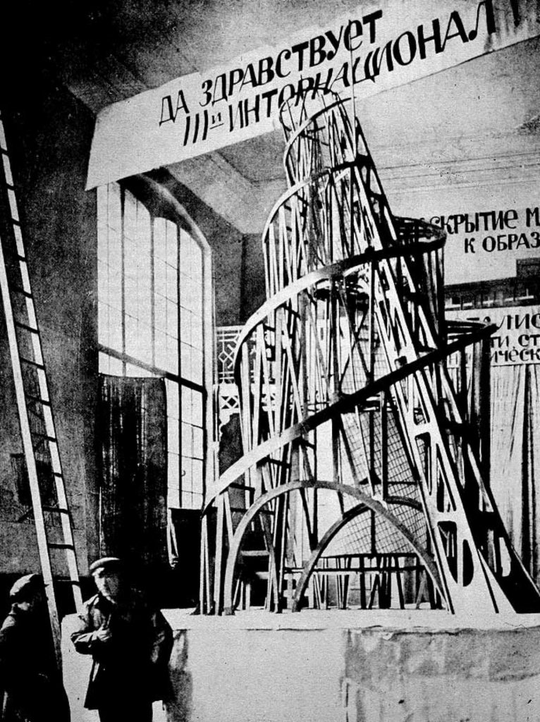Constructivism and Soviet Cinema. Vladimir Tatlin and an assistant in front of the model for the Third International, in November 1920, St. Petersburg, Russia. The original photograph is lost. Architectuul.