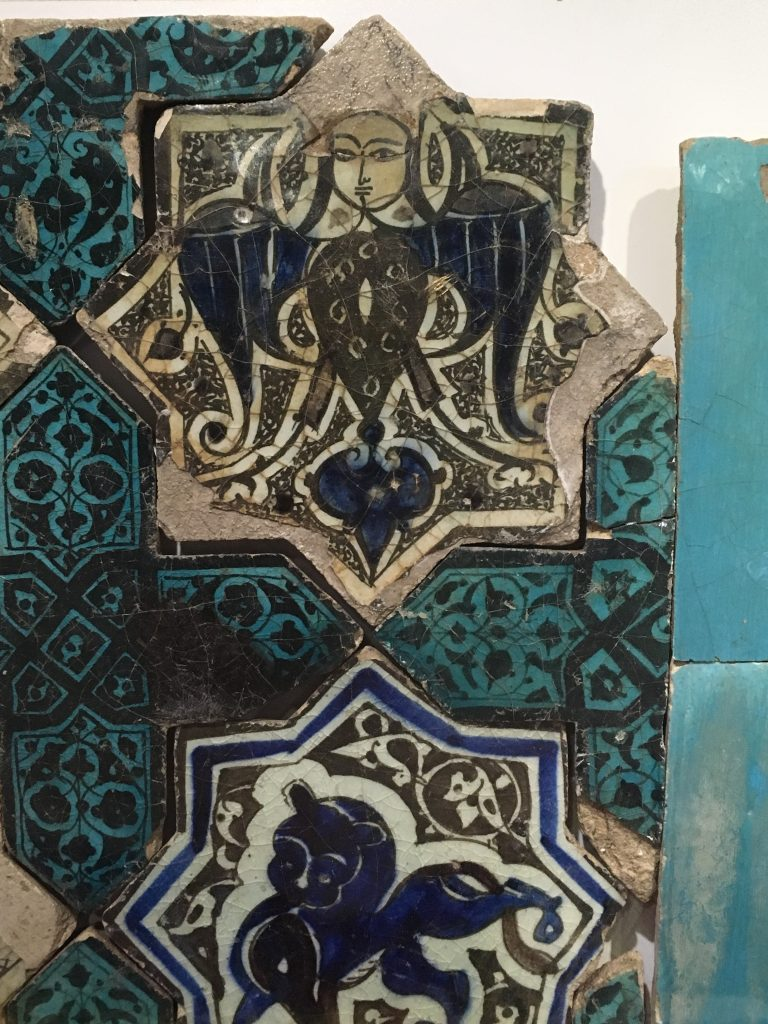 Star shaped tiles depicting a Siren and a Lion, Karatay Mederesesi Museum, Konya, Turkey.  Photo by the author.