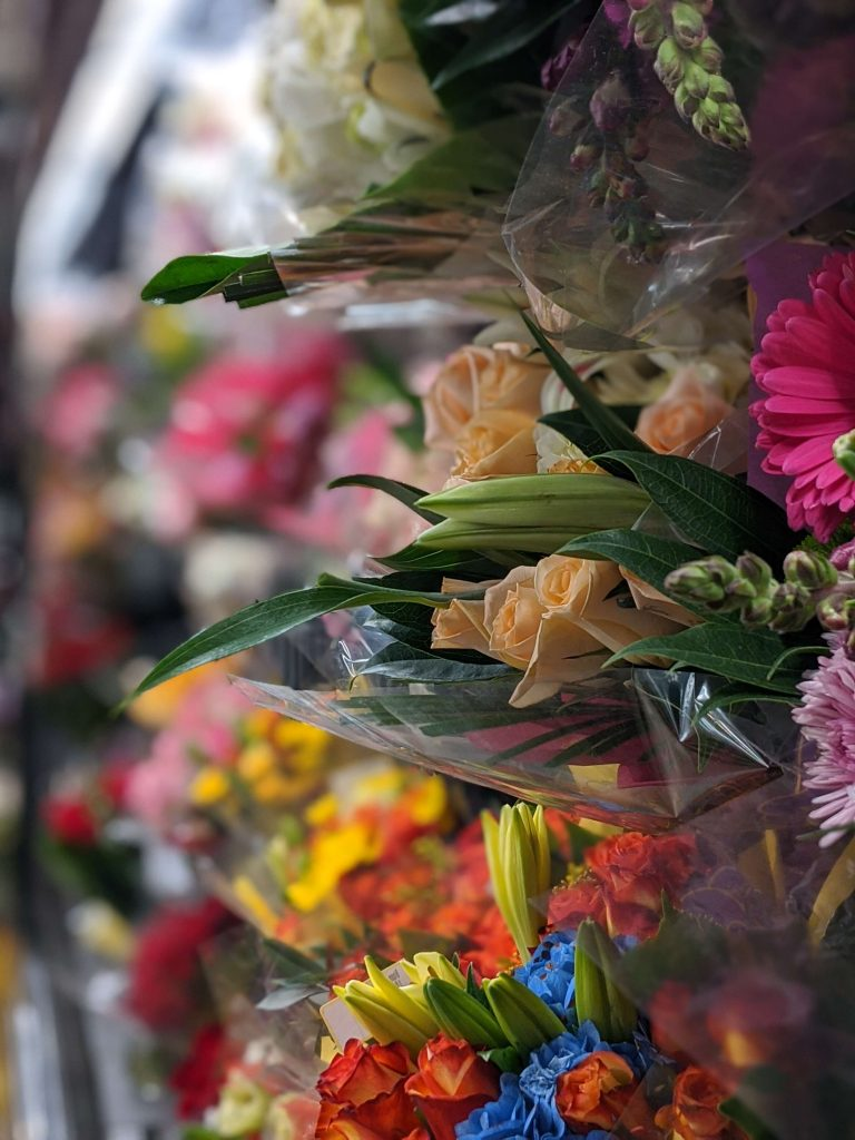 hidden messages in flora, language of flowers, photograph of bouquets of flowers in a store display