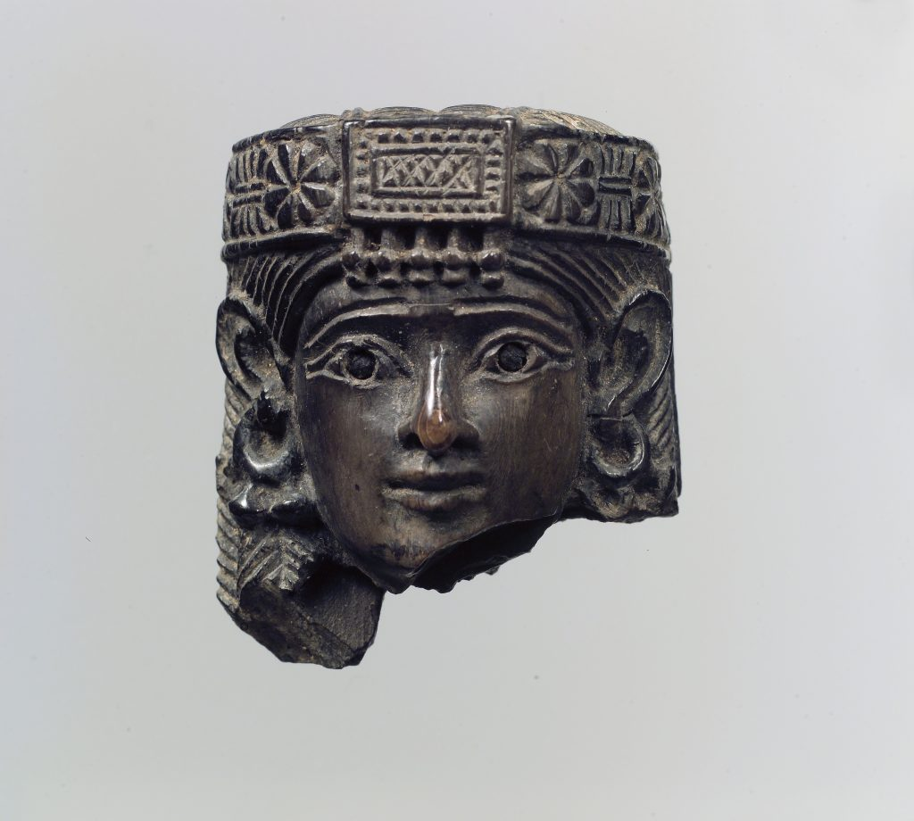 Head of a female figure blackened by fire, 8th century BCE, Neo-Assyrian Period, Metropolitan Museum of Art, New York, NY, USA.