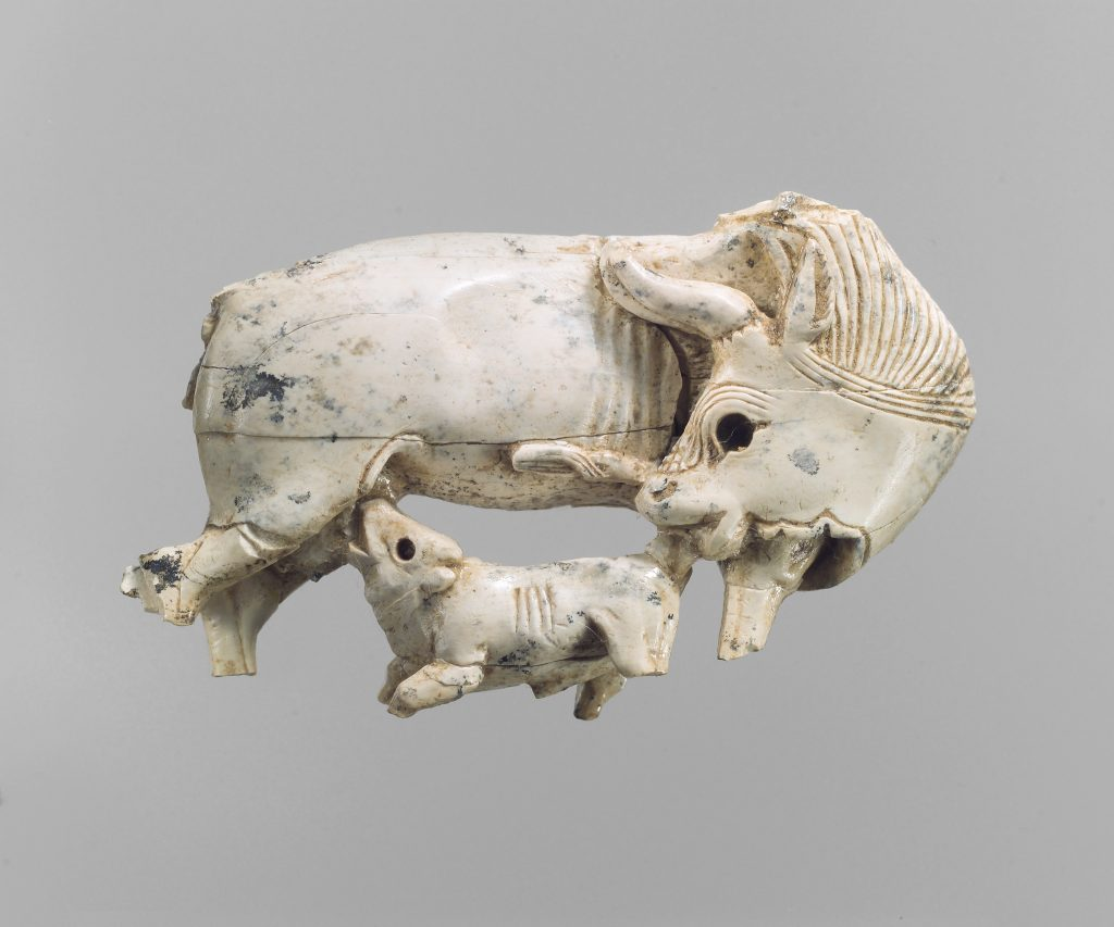Openwork furniture plaque with a cow suckling a calf, ivory carving, 9th-8th century BCE, Neo-Assyrian Period, Metropolitan Museum of Art, New York, NY, USA.