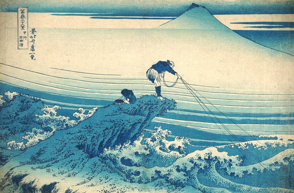 Hokusai, color woodblock print in shades of blue with fisherman and fishing lines in the foreground and Mount Fuji in the background