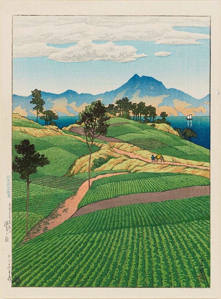 Hasui Kawase, Onsengadake Seen from Amakusa. Depicts a series of green fields, leading to the sea and a mountain in the distance.