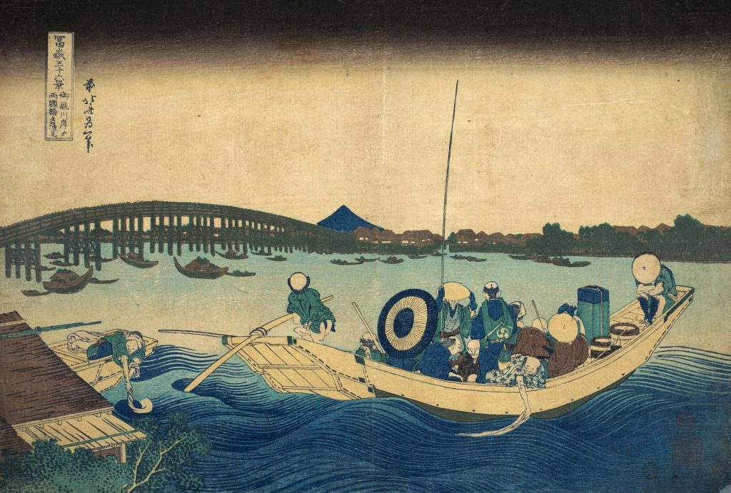 Katsushika Hokusai, Viewing the Sunset over Ryogoku Bridge from the Onmayagashi Embankment, Thirty-six Views of Mount Fuji, color woodblock print, with boat and fishermen in the foreground, bridge and Mount Fuji in the background