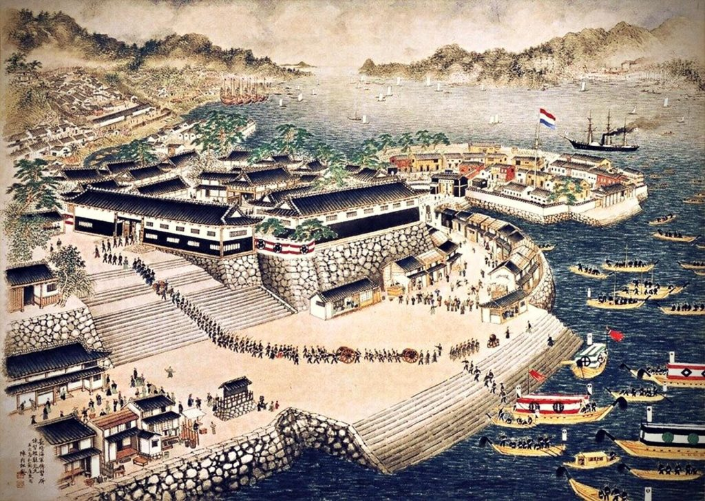 nagasaki naval training centre with the fort and many ships and soldiers in the foreground, surrounded by mountains in the background