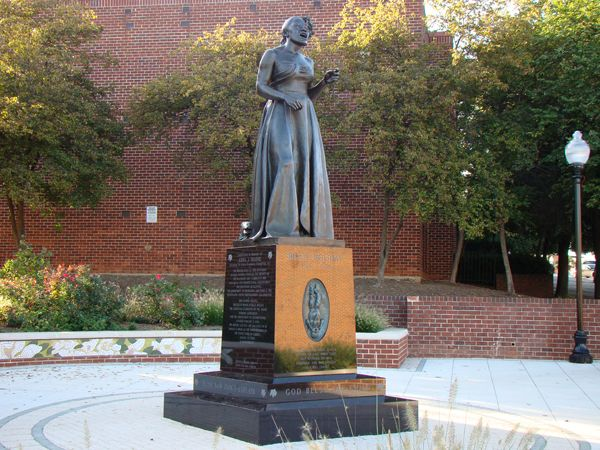 Statues of famous musicians: James Earl Reid, Billie Holiday,