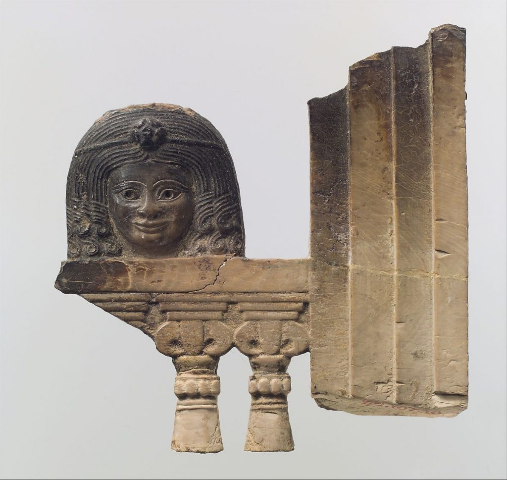 Openwork furniture plaque with a sculpture of a woman, fire singed ivory plaque, 8th century BCE, Neo-Assyrian Period,Metropolitan Museum of Art, New York, NY, USA.