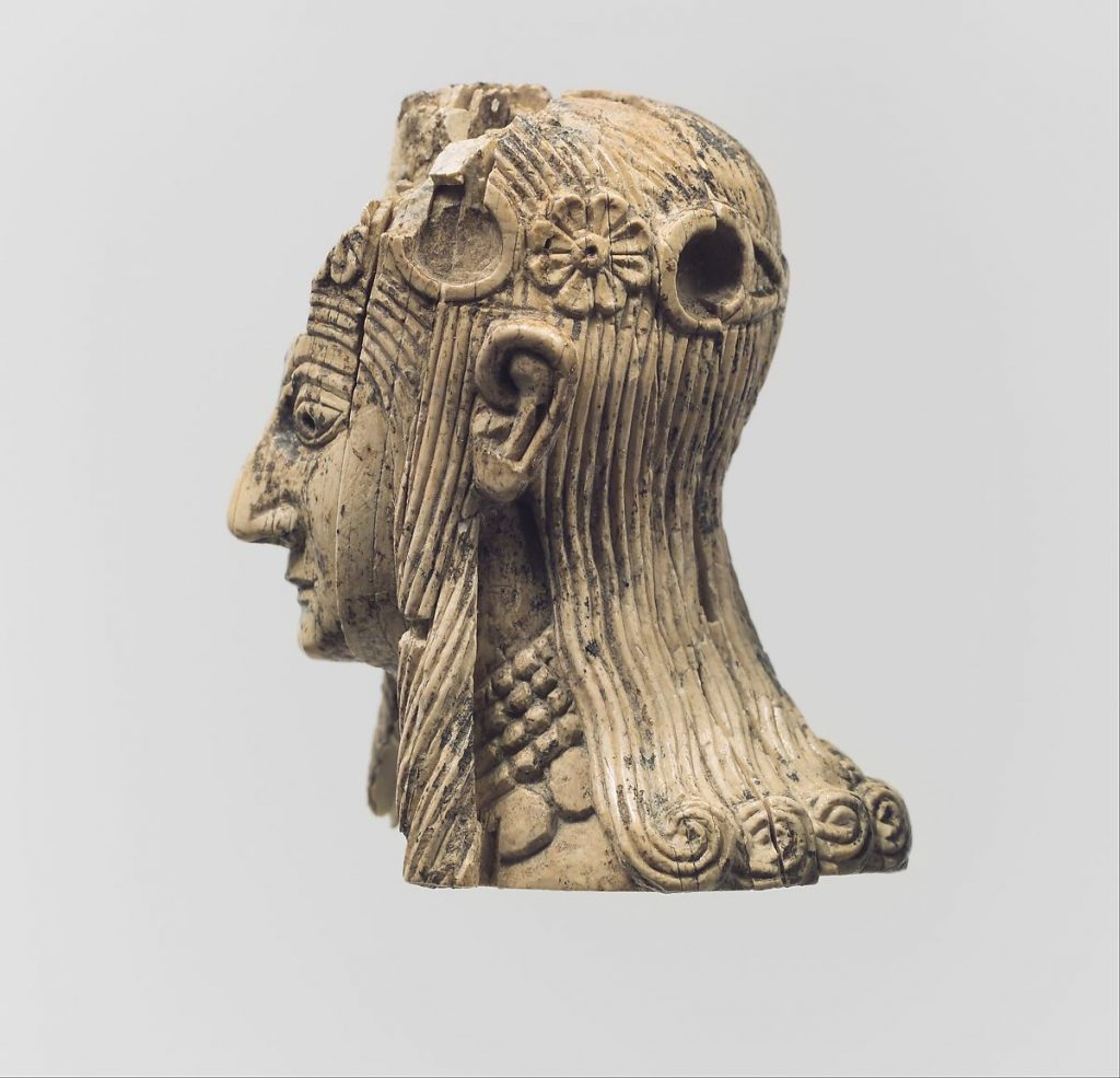 Head of a female figure with rosette diadems, ivory carving, 8th-7th century BCE, Metropolitan Museum of Art, New York, NY, USA.