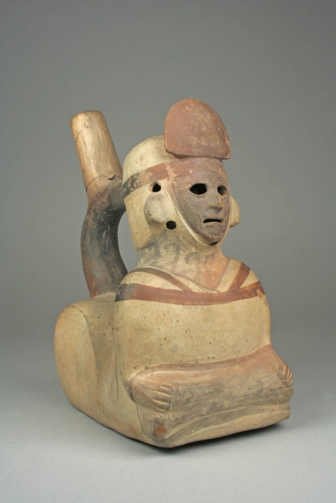 Whistling Stirrup Spout Bottle with Figure, 5th -7th century, ceramic, slip, pigment, Moche, Peru. Metropolitan Museum of Art, New York, NY, USA.
