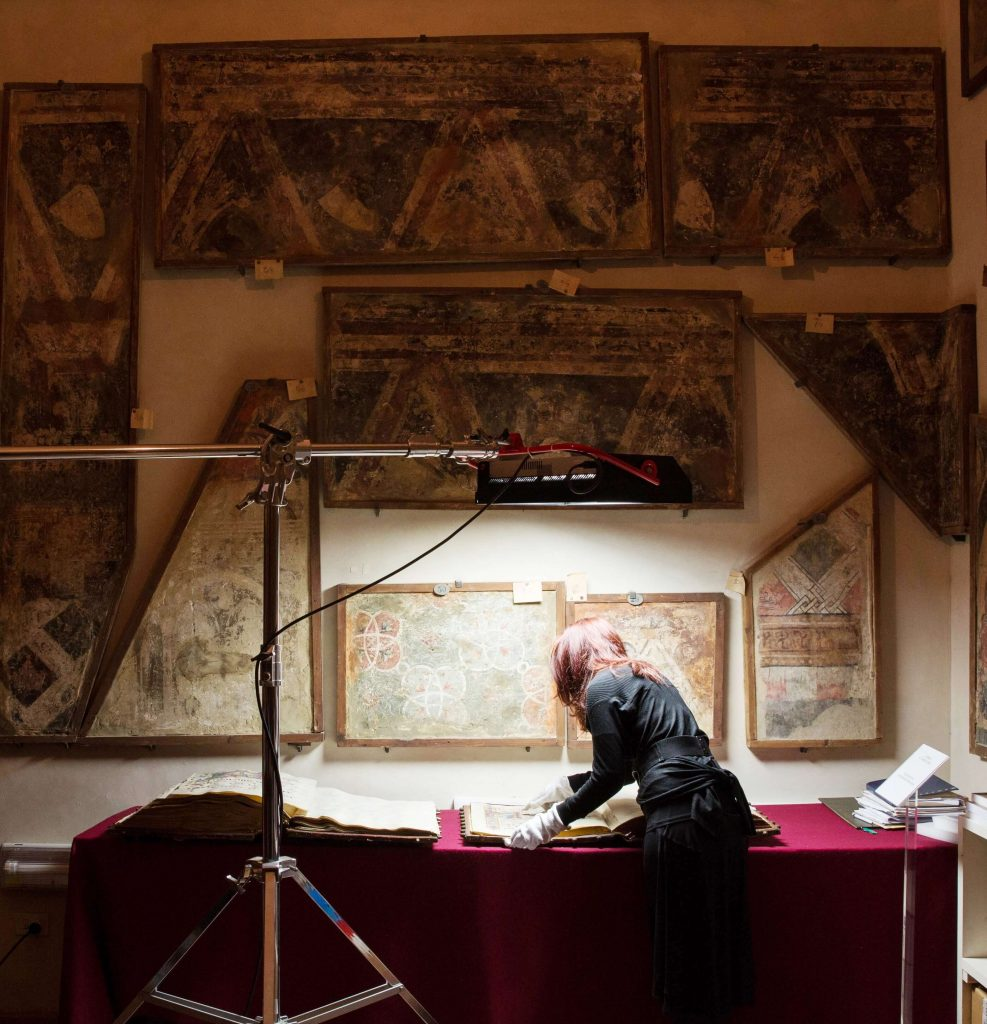 AWA Foundation Director Linda Falcone researching manuscripts by Plautilla Nelli at San Marco Museum, Florence, Italy.