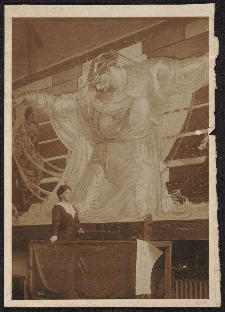 Violet Oakley with her International Unity and Understanding frieze at the Pennsylvania State Capitol, photographer unknown, 1841–1981. Archives of American Art, Smithsonian Institution.