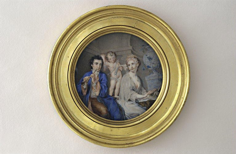 Rosalba Carriera, Round miniature scene depicting a man playing flute, a woman playing harpsichord and a putto. The scene is in a round goldlike frame.
