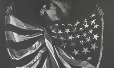 David Hammons Untitled (Man with Flag), n.d. Grease, pigment, and white crayon on paper 29 3/4 x 39 3/4 inches (75.6 x 101 cm) Glenstone Museum, Potomac, Maryland Photograph by Alex Jamison, courtesy of Mnuchin Gallery, New York
