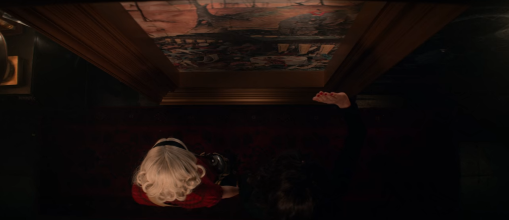 Beautiful Horrors: Art in the Chilling Adventures of Sabrina: Sabrina and Lilith stepping through the portal in Breugel's, The Triumph of Death, Season 3, Episode 5, The Chilling Adventures of Sabrina, 2019. Courtesy of Netflix.