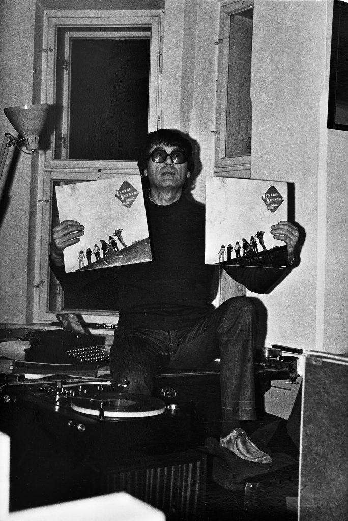 Zdzisław Beksiński and music: Zdzisław Beksiński poses with his Lynyrd Skynyrd LP's in his Sanok studio, ca 1976. Historical Museum of Sanok.