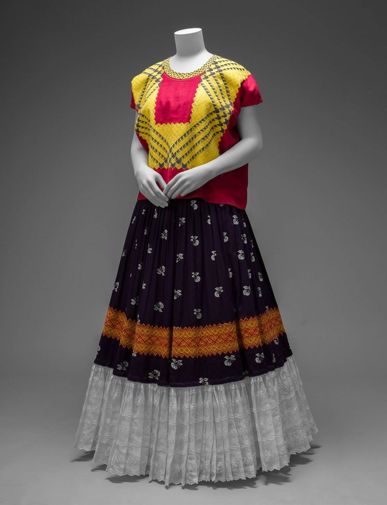 Cotton huipil with machine-embroidered chain stitch; printed cotton skirt with embroidery and holán (ruffle), Museo Frida Kahlo, Mexico City, Mexico. Photograph by Javier Hinojosa. Frida Kahlo's style