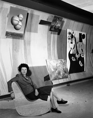 31 Women Peggy Guggenheim at The Art of This Century Gallery, with two paintings in the 31 Women exhibition