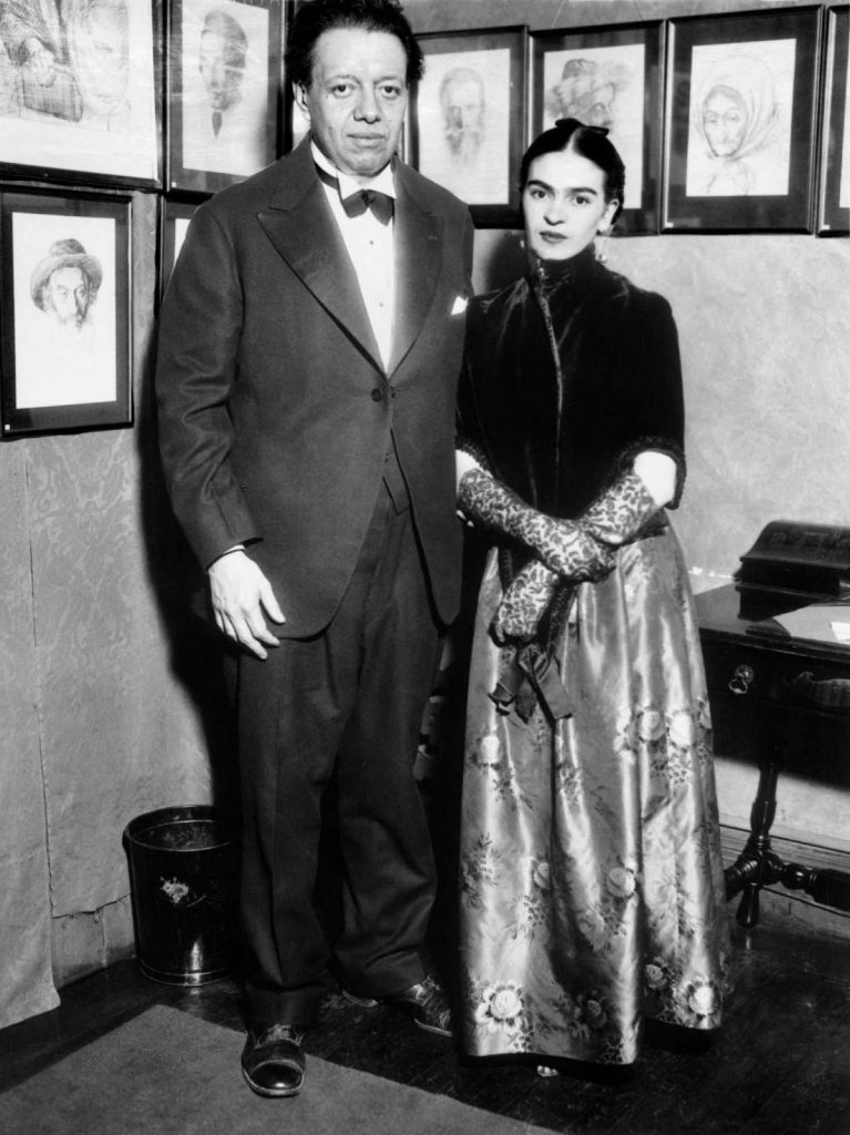 Diego Rivera and Frida Kahlo attending an art exhibition in New York, 1933.