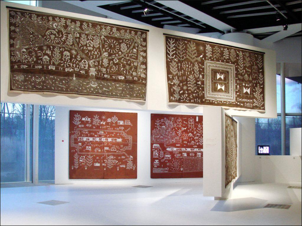 """Warli painting, Works of Jivya Soma Mashe at the exhibition """"Autres Maîtres de l'Inde, créations contemporaines des Adivasi,"""" Musée du Quai Branly, Paris."""