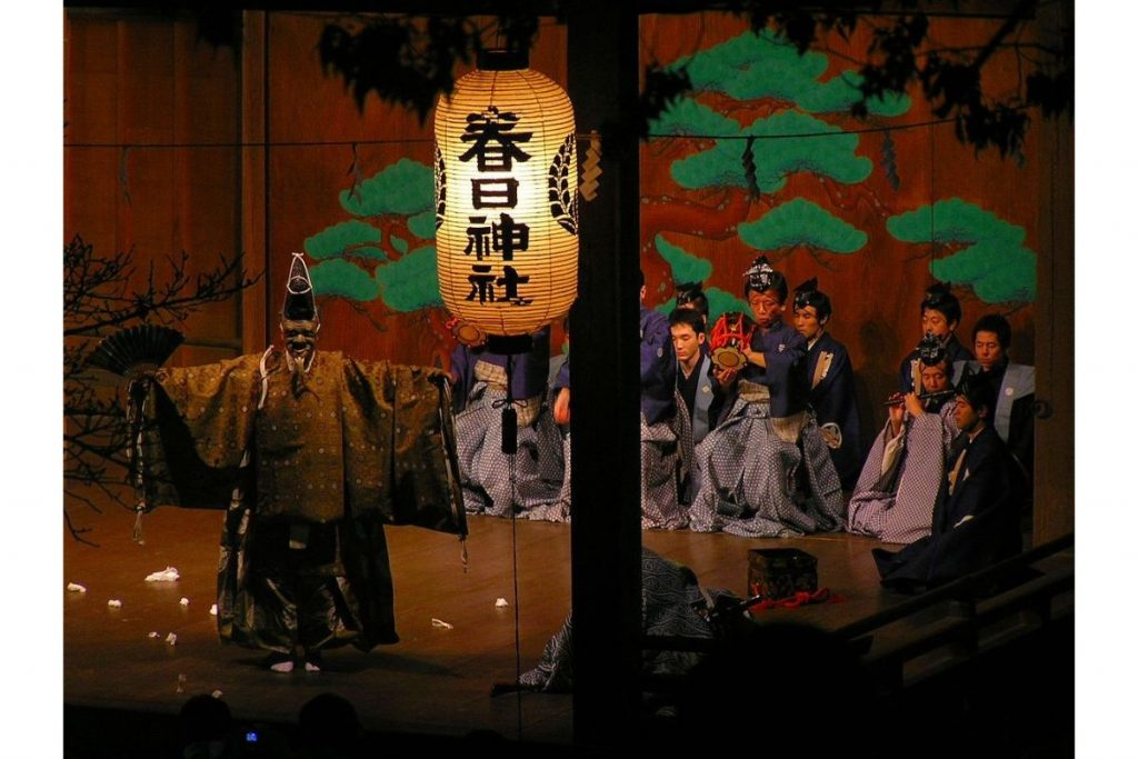 Shadows in Japanese culture: Modern rendering of Okina, beginning part of Nō plays performed on special occasions, such as New Year's Day.