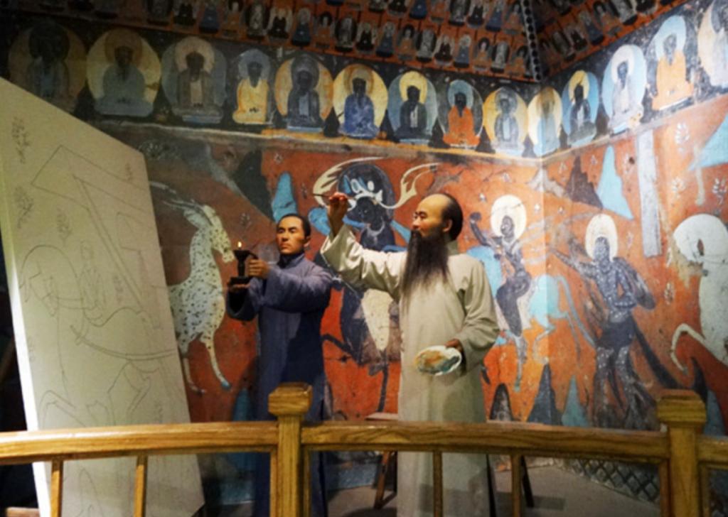 A wax figure of Zhang Daqian painting at Dunhuang, Sichuan Museum, Qingyang District, Chengdu, China.