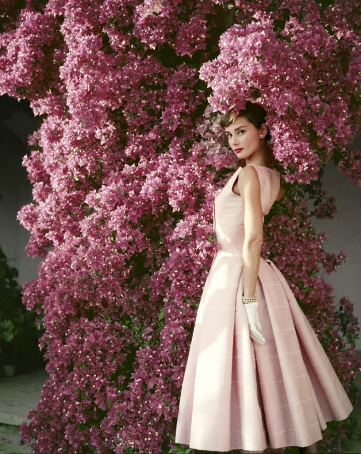 Norman Parkinson, Audrey Hepburn wearing a Givenchy afternoon cocktail dress, Italy, 1955.