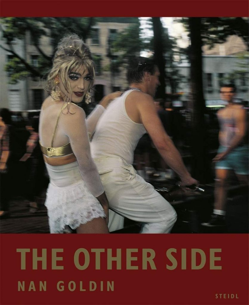 Nan Goldin's incredible images of transgender women in The Other Side are a must see. Book cover of The Other Side by Nan Goldin, Steidl, 2019.