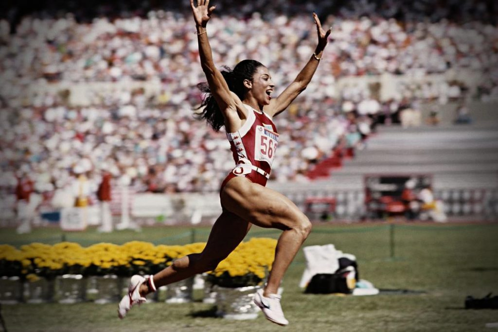 Florence Griffith Joyner celebrates her 100-meter win during the Olympic Games in Seoul, Korea, 1988, Olympics