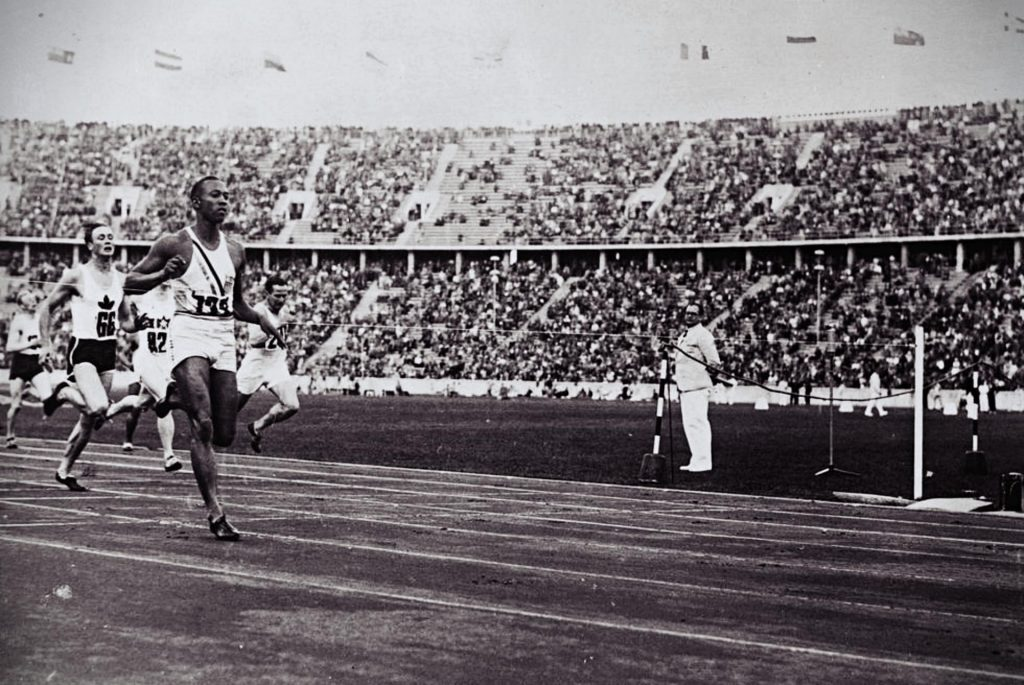 Jesse Owens competing in a race during the Olympic Games in Berlin, 1936.