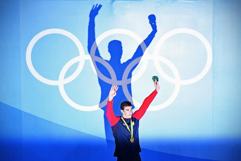 Michael Phelps celebrates on the podium during the medal ceremony at the Olympic Games in Rio de Janeiro, 2016, Olympics