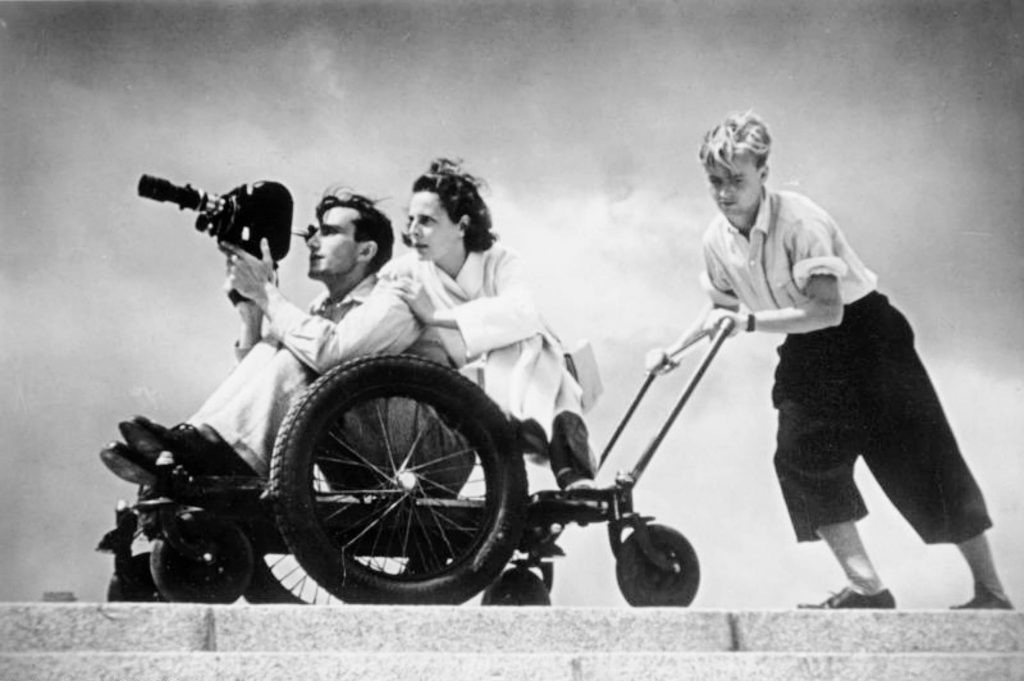 Riefenstahl filming a scene, 1936, photography, Olympics