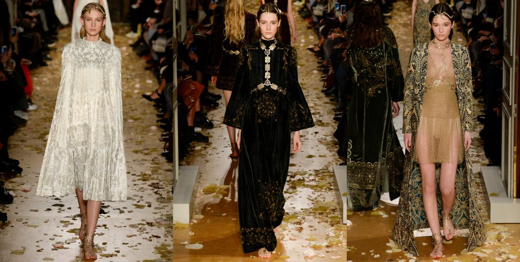 three photographs presenting looks from Valentino's Byzantine Art - inspired fashion show: left withe cape dress, centre: black long gown with gold accessories, right: sheer-gold dress with black and gold embroidered cape