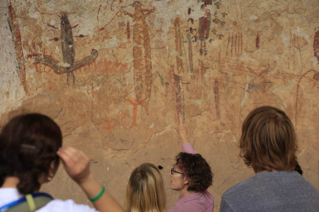 Dr. Carolyn Boyd discusses Pecos River style rock art with field school students, Val Verde County, TX, USA.