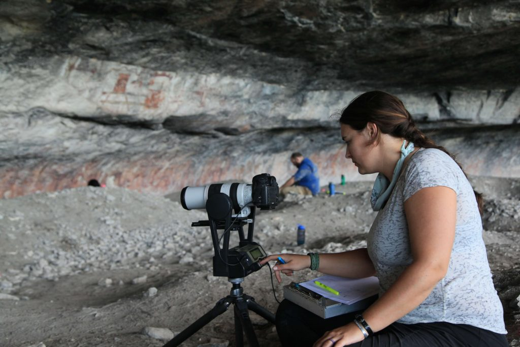 Amanda Castaneda sets up the Gigapan while crew works in the background at Fate Bell Shelter, Seminole Canyon State Park & Historic Site, Comstock, TX, USA.