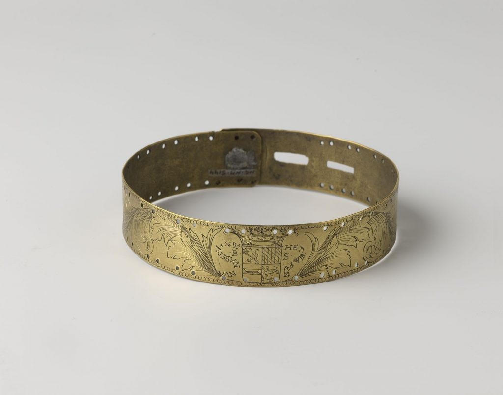 Review of the Slavery Exhibition at Rijksmuseum. Brass collar, 1689. This neckband was originally categorized as a dog collar, but was possibly worn by a human being. Rijksmuseum, Amsterdam, Netherlands.
