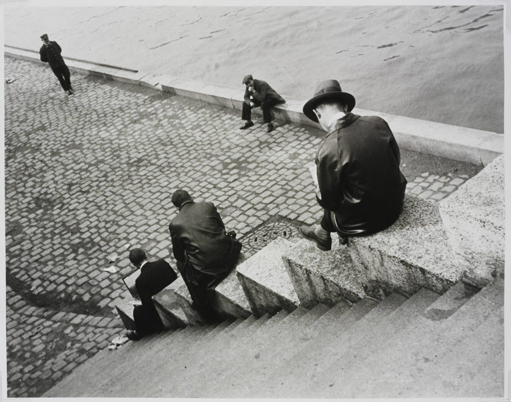 Ilse Bing, Three Men Sitting on the Steps by the Seine, 1931, Victoria and Albert Museum, London, UK.